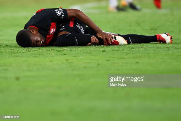 Roly Bonevacia of the Wanderers holds his leg after falling during the round 20 ALeague match between the Western Sydney Wanderers and the Newcastlee...