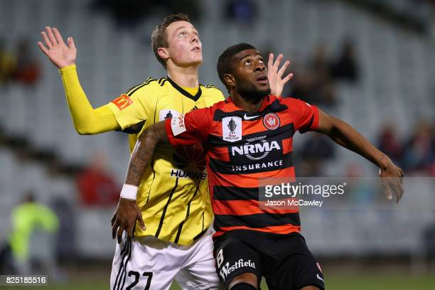 Roly Bonevacia of the Wanderers is challenged by Liam Wood of the Phoenix during the FFA Cup round of 32 match between the Western Sydney Wanderers...