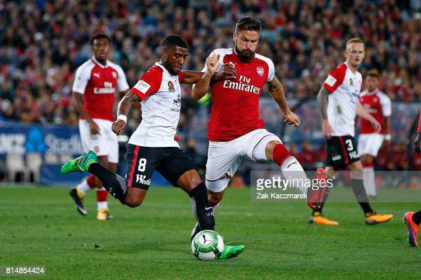 Roly Bonevacia of the Wanderers is challenged by Olivier Giroud of Arsenal during the match between the Western Sydney Wanderers and Arsenal FC at...