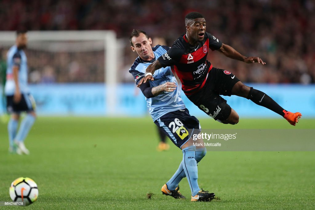 Roly Bonevacia of the Wanderers is tackled by Luke Wilkshire of Sydney FC during the round three A-League match between Sydney FC and the Western Sydney Wanderers at Allianz Stadium on October 21, 2017 in Sydney, Australia.