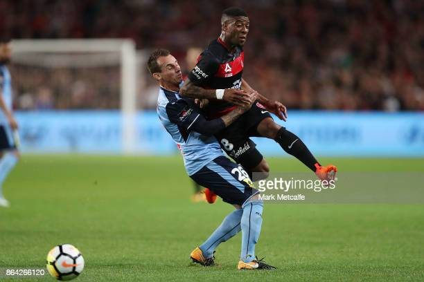 Roly Bonevacia of the Wanderers is tackled by Luke Wilkshire of Sydney FC during the round three ALeague match between Sydney FC and the Western...