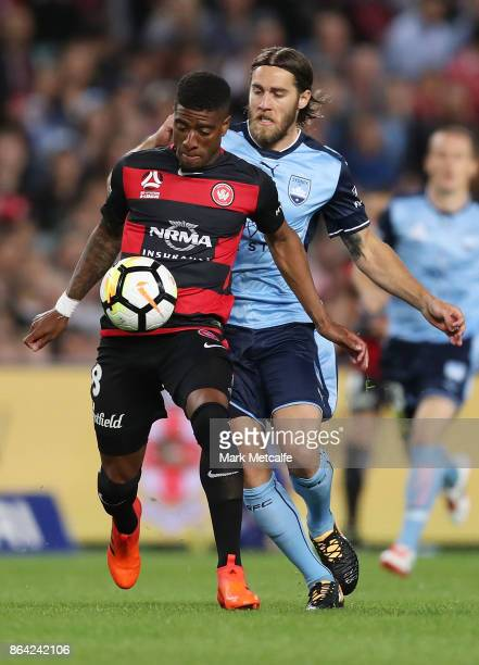 Roly Bonevacia of the Wanderers takes on Joshua Brilliante of Sydney FC during the round three ALeague match between Sydney FC and the Western Sydney...