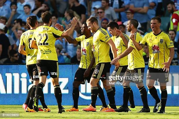 Roly Bonevacia of Wellington Phoenix celebrates with team mates after scoring a goal during the round 23 ALeague match between Sydney FC and the...