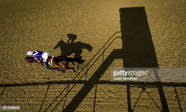 Roly Tricks riden by Harry Bentley in action during the 32Red On The App Store Median Auction Maiden Stakes at Lingfield Park on July 9 2014 in...