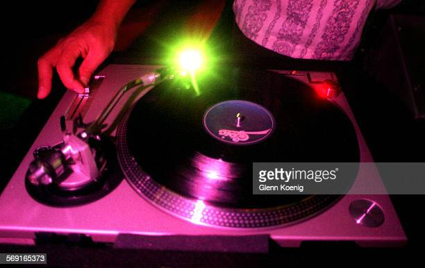 Roly.Spin.1130.GK–DJ Roly Quiambao ,spinning a record while working as disc jockey at the Shark Club, Costa Mesa. Reporter:Zan dubin