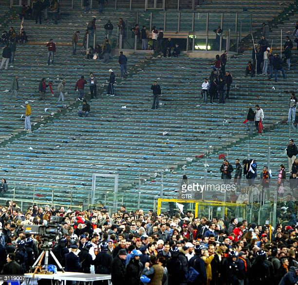 Roma and Lazio supporters leave Olympic stadium in Rome after the match was cancelled at halftime 21 March 2004 Players stopped the game when...