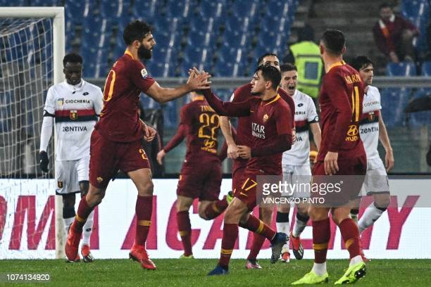 AS Roma Argentine defender Federico Fazio celebrates with AS Roma Turkish forward Cengiz Under after scoring the 12 goal during the Italian Serie A...
