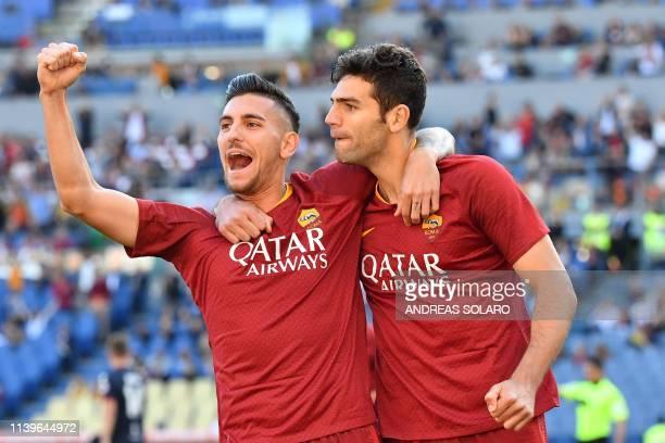 Roma Argentine defender Federico Fazio celebrates with his team mate AS Roma Italian midfielder Lorenzo Pellegrini after scoring a goal during the...