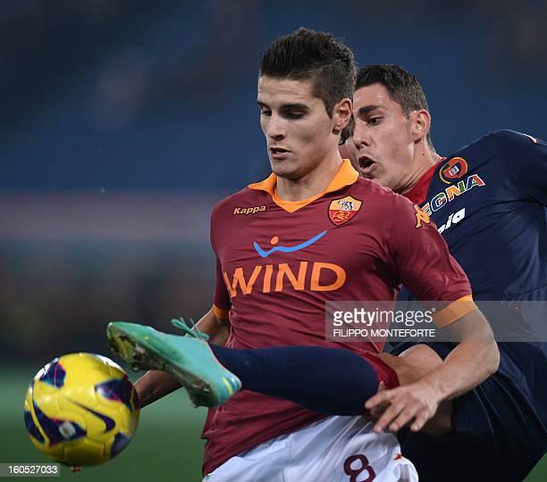 Roma Argentine forward Erik Lamela vies with Cagliari's Brazilian defender Danilo Fernando Avelar during the Serie A football match AS Roma vs...