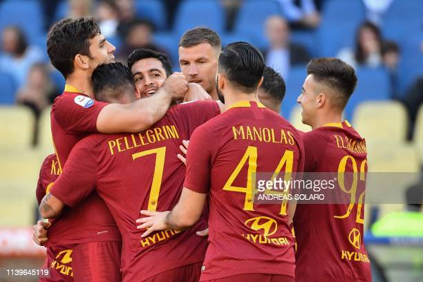 AS Roma Argentine midfielder Javier Pastore celebrates with his teammates after scoring during the italian Serie A football match between AS Roma and...