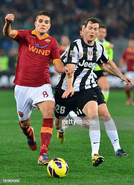 Roma Argentinian forward Erik Lamela vies with Juventus' Swiss defender Stephan Lichtsteiner during the Italian Serie A football match between AS...