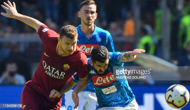 AS Roma Bosnian forward Edin Dzeko and Napoli's Albanian defender Elseid Hysaj go for the ball during the Italian Serie A football match AS Roma vs...