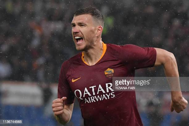 Roma Bosnian forward Edin Dzeko celebrates after opening the scoring during the Italian Serie A football match AS Roma vs Udinese on April 13, 2019...