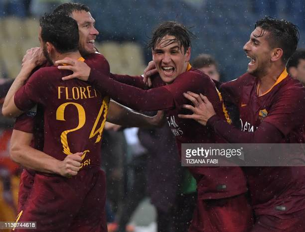 AS Roma Bosnian forward Edin Dzeko celebrates with AS Roma Italian midfielder Alessandro Florenzi AS Roma Italian midfielder Nicolo Zaniolo and AS...