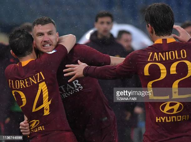 AS Roma Bosnian forward Edin Dzeko celebrates with AS Roma Italian midfielder Alessandro Florenzi and AS Roma Italian midfielder Nicolo Zaniolo after...