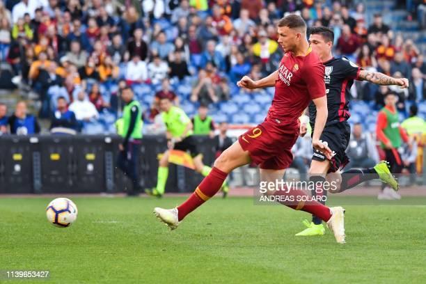 Roma Bosnian forward Edin Dzeko kicks the ball during the Italian Serie A football match between AS Roma and Cagliari on April 27, 2019 at the...