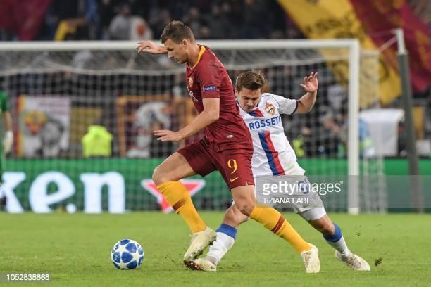 AS Roma Bosnian forward Edin Dzeko outruns CSKA Moscow's Russian midfielder Ivan Oblyakov during the UEFA Champions League group G stage football...