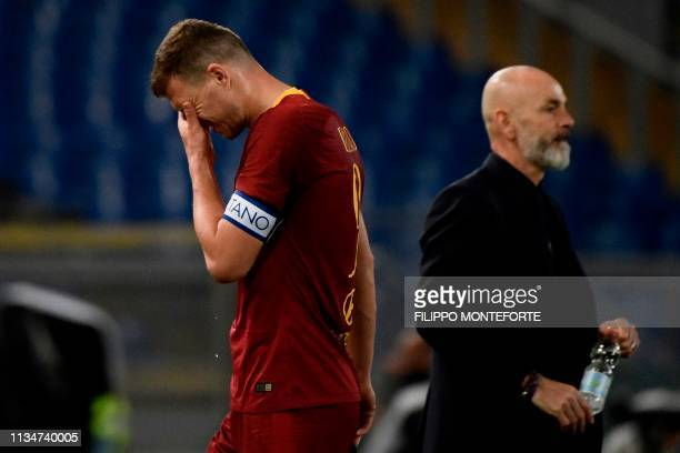 AS Roma Bosnian forward Edin Dzeko reacts next to Fiorentina's Italian coach Stefano Pioli at the end of the Italian Serie A football match AS Roma...