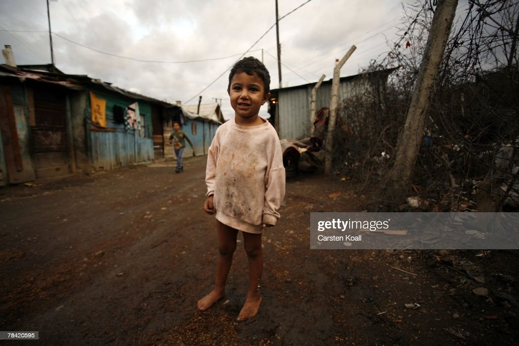 A Roma boy stands in the mud in the Cesmin Lug refugee camp in the Serbian district December 12, 2007 in Kosovo province, Serbia. One hundred and fourty-four refugees live in the camp near toxic metal waste left by the Trepca mines, living in extremely poor conditions with no running water. Members of the Roma minority were forced to flee their homes in the Mahala district in southern Mitrovica during the Kosovo war in the 1999. They settled in the Serb-populated northern side of the divided province. Were independence to come to Kosovo, the north would continue as a Serbian enclave. Kosovo, administered by the United Nations since the 1990 conflict, is home to approximately 120,000 Serbs, who face an uncertain future should the province, with its majority Albanian population, become independent under a U.N. proposed plan.