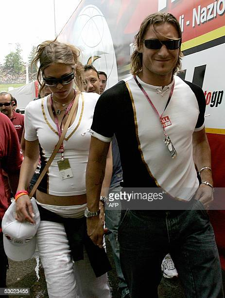 Roma Capitano Francesco Totti arrives with his girlfriend Ilary at Mugello's race track to follow Italian Grand Prix 05 June 2005 Valentino Rossi of...