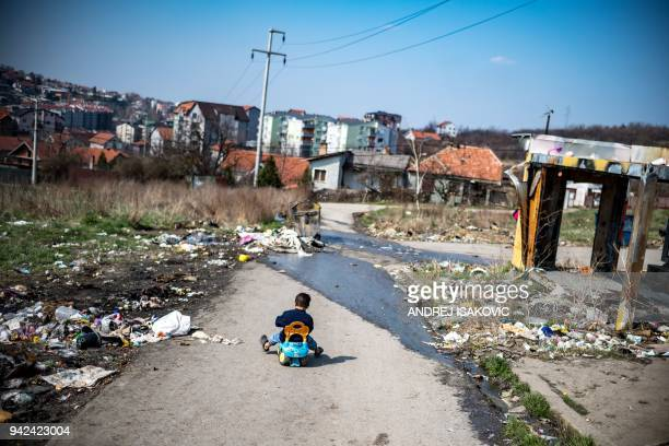 A Roma child plays at a makeshift camp in Belgrade on March 28 2018 Bekim Gashi and Kasandra Cac are neighbours in Orlovsko Naselje a Roma area in...