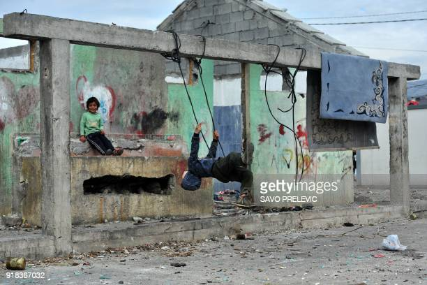 Roma children play on a makeshift swing at a camp in the suburb of Konik in Podgorica on February 6 2018 It was not their war but the 1990s Kosovo...