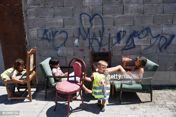 Roma children sit in front of their house in the Roma neighborhood in the town of Mitrovica on July 7 2017 The Roma 'are not treated like humans'...