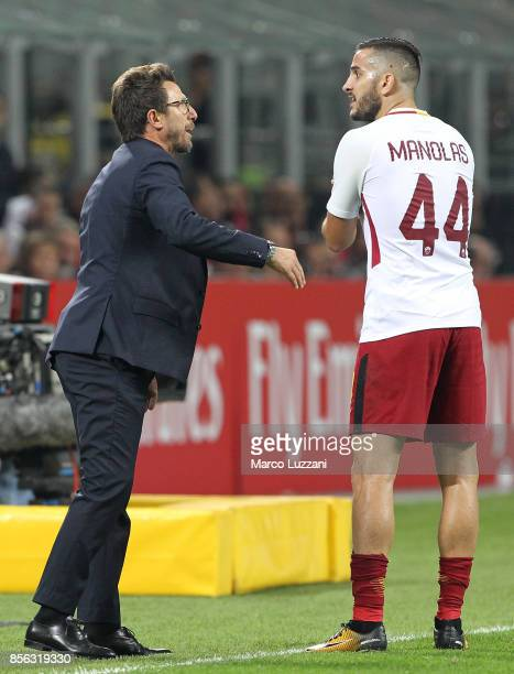 Roma coach Eusebio Di Francesco issues instructions to his player Konstantinos Manolas during the Serie A match between AC Milan and AS Roma at...