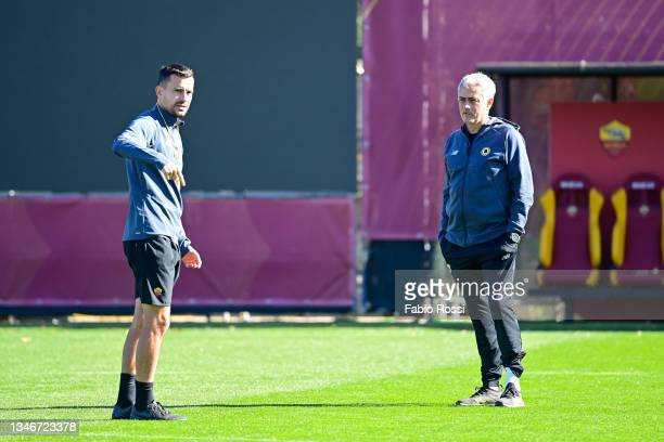 Roma coach Josè Mourinho and his assistant Joao Sacramento during a training session at Centro Sportivo Fulvio Bernardini on October 15, 2021 in...