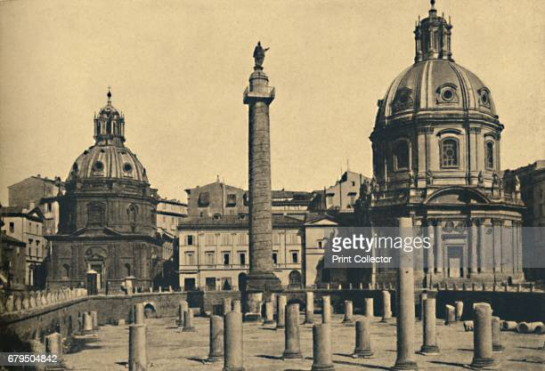 Roma Column of Trajan' 1910 Commemorating Roman emperor Trajan's victory in the Dacian Wars with remains of the columns of the Basilica Ulpia...