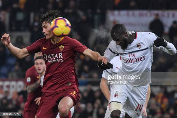 Roma Czech forward Patrik Schick and AC Milan's French midfielder Tiemoue Bakayoko go for a header during the Italian Serie A football match AS Roma...