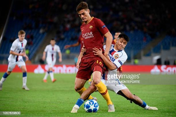 AS Roma Czech forward Patrik Schick holds off CSKA Moscow's Russian midfielder Ilzat Akhmetov during the UEFA Champions League group G stage football...