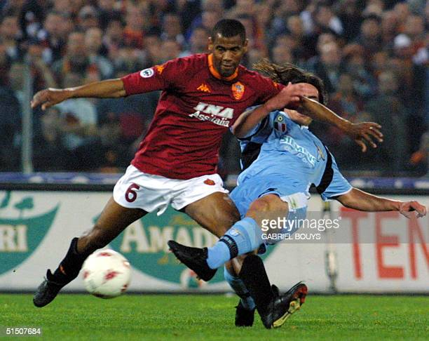 Roma defender Brazilian Aldair Nascimento fights for the ball with a Lazio Rome player 29 April 2001 during their Italian first league derby game at...
