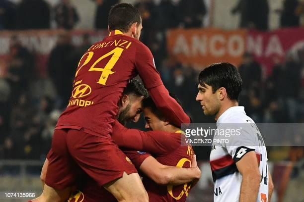 AS Roma Dutch forward Justin Kluivert and AS Roma Italian midfielder Alessandro Florenzi embrace AS Roma Italian midfielder Bryan Cristante after...