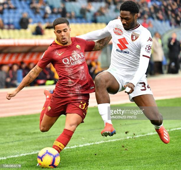 AS Roma Dutch forward Justin Kluivert centres past Torino's Nigerian defender Ola Aina during the Italian Serie A football match AS Roma vs Torino on...