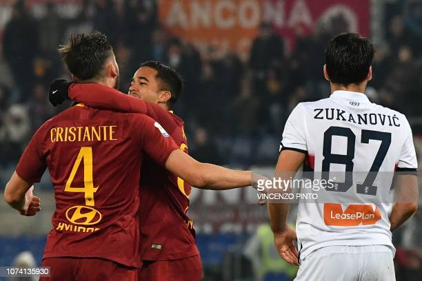 AS Roma Dutch forward Justin Kluivert embraces AS Roma Italian midfielder Bryan Cristante after Cristante scored the 32 goal during the Italian Serie...