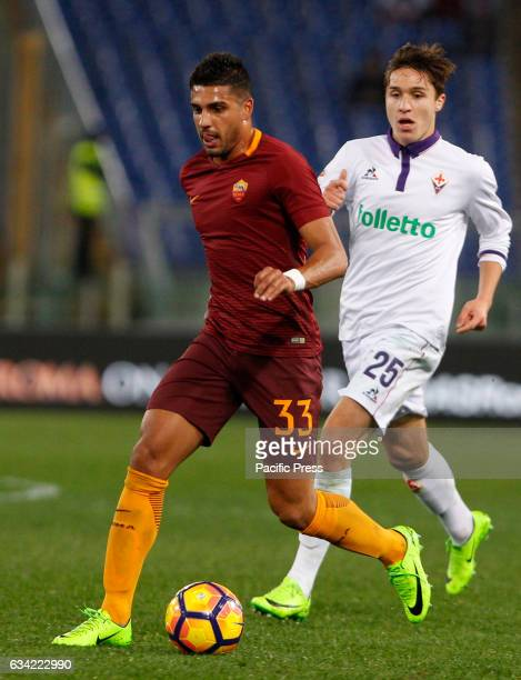 Roma Emerson Palmieri left is chased by Fiorentina Federico Chiesa during the Italian Serie A soccer match between Roma and Fiorentina at the Olympic...