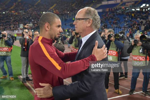 Roma ex player Paolo Roberto Falcao meets his brasilian countryman Bruno Peres before the UEFA Europa League Round of 32 second leg match between AS...