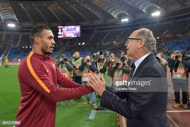 Roma ex player Paolo Roberto Falcao meets his brasilian countryman Juan Jesus before the UEFA Europa League Round of 32 second leg match between AS...