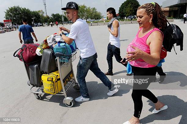 Roma family during their arrival at the Pristina airport on July 20, 2010. For Roma kids expelled by Germany, Kosovo is a nightmare.They arrived in...