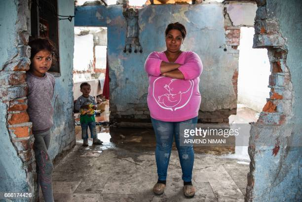 A Roma family pose in their shelter at a Roma Camp in the village of Plemetina on April 8 during the international Roma Day marked around Europe to...