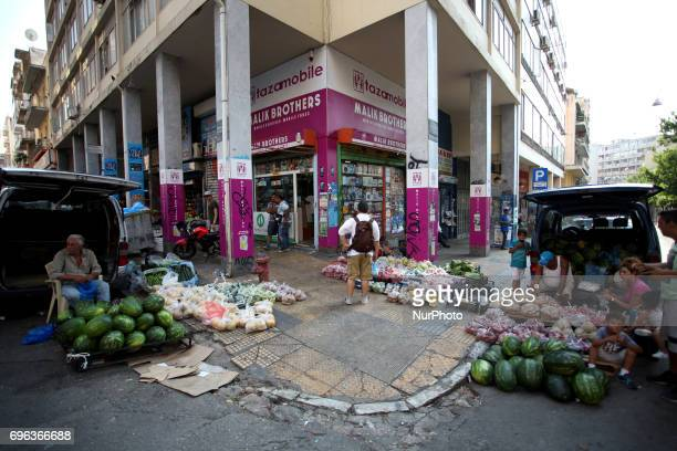 A Roma family selling fruits and vegetables in Athens city center Greece June 15 2017