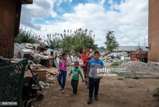 Roma family walks outside an occupied building on October 4 2017 in Rome Italy For the last 5 years hundreds of people including Italians Roma and...