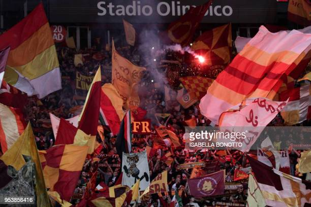 Roma fans cheer ahead of the UEFA Champions League semi-final second leg football match between AS Roma and Liverpool at the Olympic Stadium in Rome...