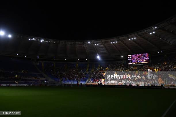 Roma fans cheer as a new scenography is displayed prior to the UEFA Europa League Group J football match AS Roma vs Istanbul Basaksehir on September...
