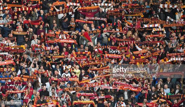 AS Roma fans cheer during the Italian Serie A football match AS Roma vs Udinese on April 13 2019 at the Olympic stadium in Rome