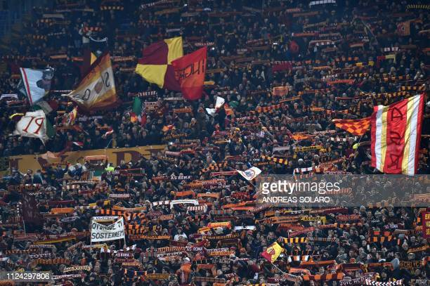 Roma fans cheer during the UEFA Champions League round of 16, first leg football match AS Roma vs FC Porto on February 12, 2019 at the Olympic...