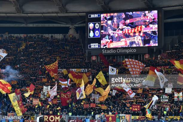 AS Roma fans cheer prior to the UEFA Champions League round of 16 first leg football match AS Roma vs FC Porto on February 12 2019 at the Olympic...