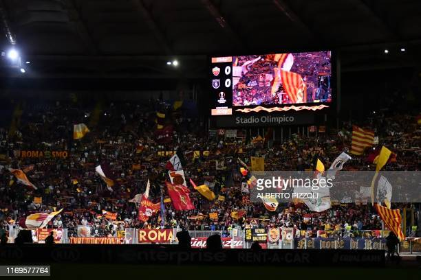 Roma fans cheer prior to the UEFA Europa League Group J football match AS Roma vs Istanbul Basaksehir on September 19, 2019 at the Olympic stadium in...