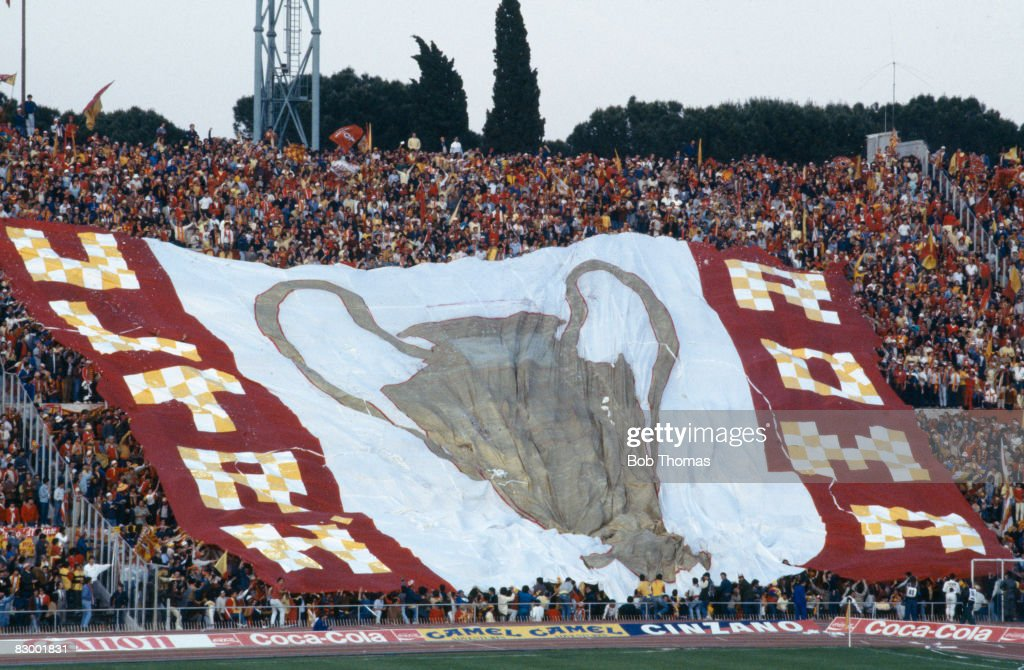 AS Roma fans display a huge flag prior to the European Cup Final against Liverpool at the Olympic Stadium in Rome, May 30th 1984. The match ended 1-1 after extra-time, with Liverpool eventually winning 4-2 on penalties.